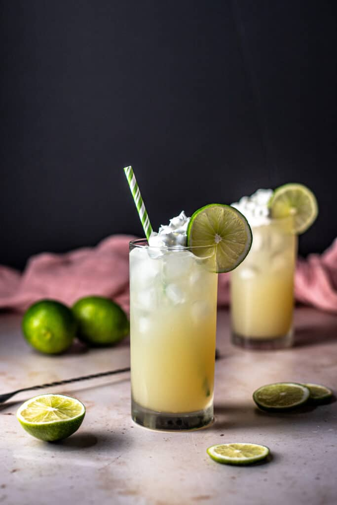 two key lime pie crush cocktails, one with a straw