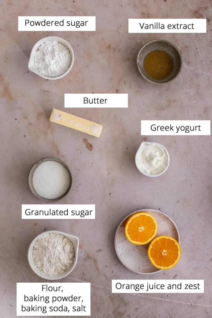 ingredients for making orange cookies, viewed from overhead