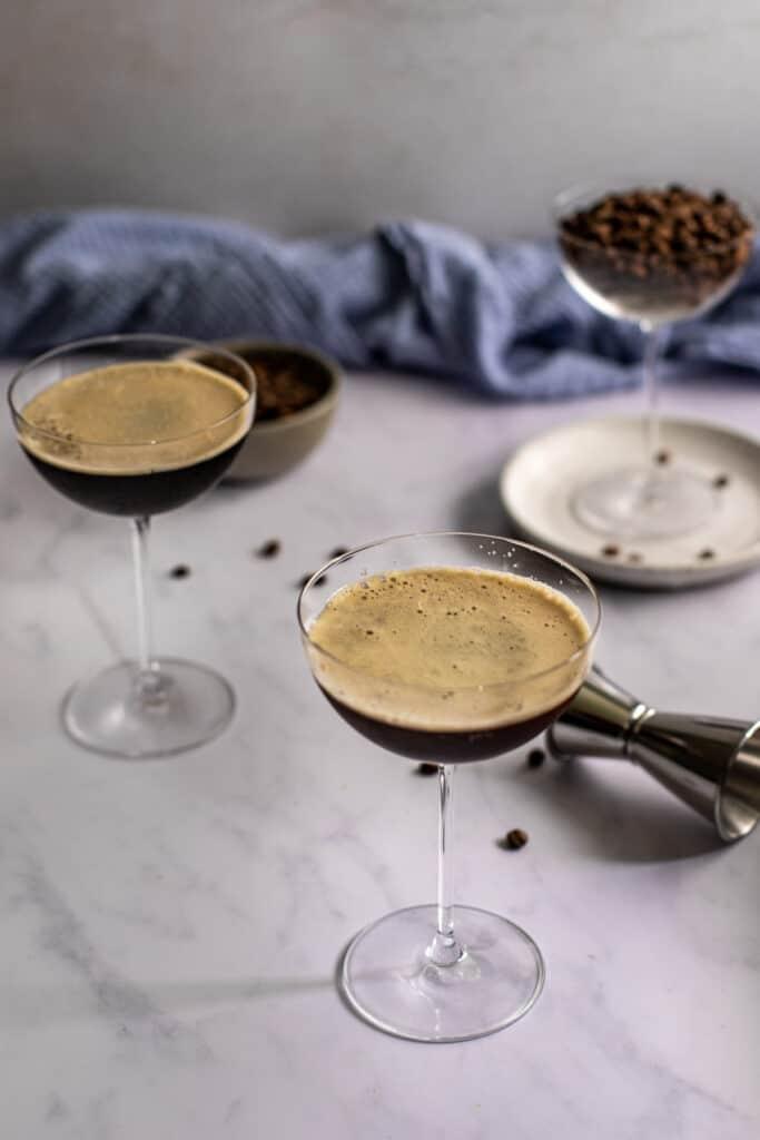45 degree angle of 2 espresso martinis in coupe glasses