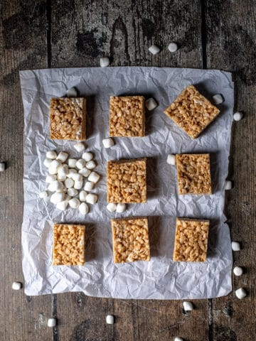 overhead view of peanut butter rice krispie treats on a sheet of parchment paper