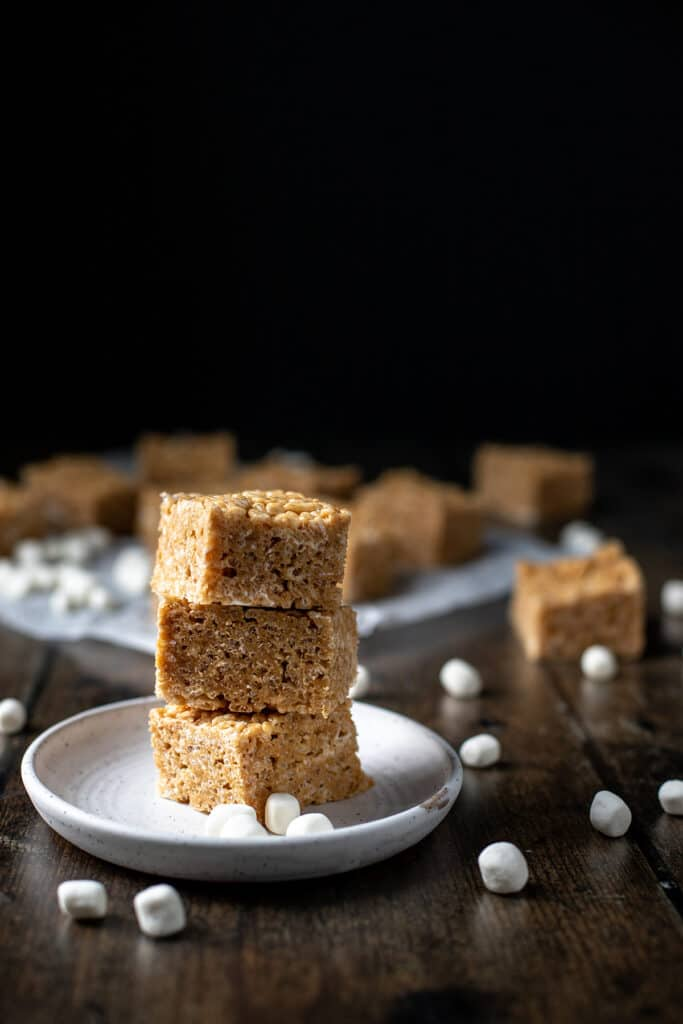 a stack of three peanut butter rice krispie treats on a white plate