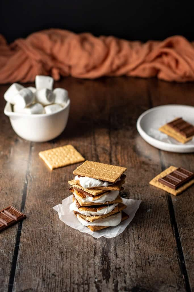 a stack of s'mores on a dark wooden background